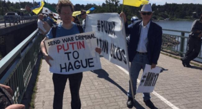 """Путина в Финляндии """"радужно"""" встретили с плакатами и скандированием """"Путин ху*ло!"""" (ФОТО)"""