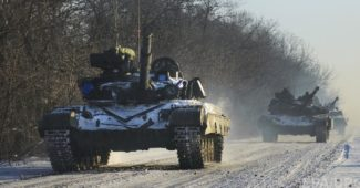 epa04544467 A picture made available 01 January 2015 shows tanks of the Ukrainian army moving near Peski village, Donetsk area, Ukraine, 31 December 2014, few hours before the 2015 celebrations. Ukrainian President Poroshenko on 29 December had signed a law that cancels Ukraine's non-aligned status and promised to initiate reform allowing Ukraine to comply with NATO standards as well as to hold a referendum on joining the alliance, a step opposed by Russia.  EPA/OLGA IVASHCHENKO  EPA/OLGA IVASHCHENKO  EPA/OLGA IVASHCHENKO